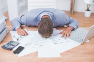 Businessman being depressed by accounting